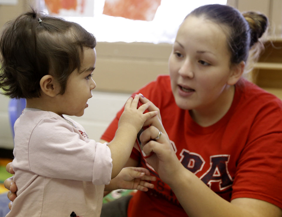 Photo - Erica Ortiz and her daughter, Kristina, 1, hope to benefit from the planned opening of a Variety Care health clinic at Emerson High School, Friday, February 15, 2013. Photo by Doug Hoke, The Oklahoman