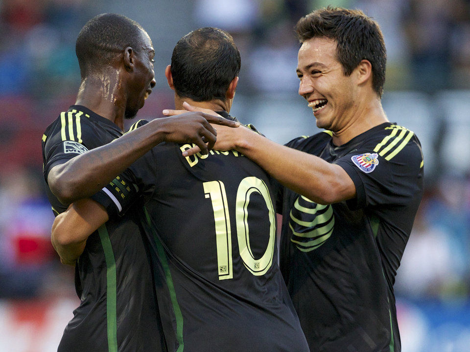 Photo - MLS All-Stars forward Bradley Wright-Phillips, left, of the New York Red Bulls, celebrates his score with midfielder Landon Donovan (10), of the Los Angeles Galaxy, and forward Erick Torres, of Chivas USA, against Bayern Munich in the MLS All-Star soccer game, Wednesday, Aug. 6, 2014, in Portland, Ore. The All-Stars won 2-1. (AP Photo/The Oregonian, Randy L. Rasmussen)