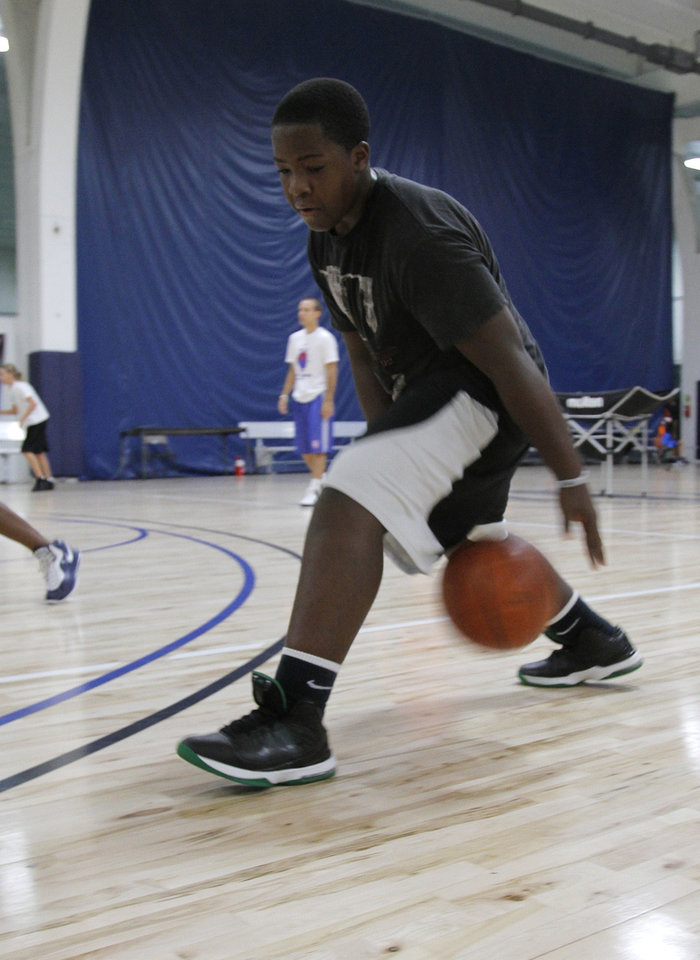 Photo - Grant Newton, 13 of Edmond, does drills during the Blake Griffin basketball camp at the Santa Fe Family Life Center in Oklahoma City Thursday, Aug. 4, 2011.  Photo by Garett Fisbeck, The Oklahoman