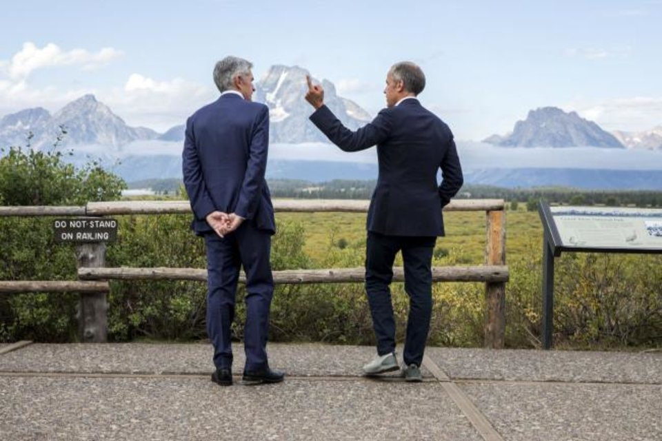 Photo - Jerome Powell, Chairman of the Board of Governors of the Federal Reserve System, left, and Bank of England Governor Mark Carney, right, pause in front of Mt. Moran after Powell's speech at the Jackson Hole Economic Policy Symposium on Friday, Aug. 23, 2019, in Jackson Hole, Wyo. (AP Photo/Amber Baesler)