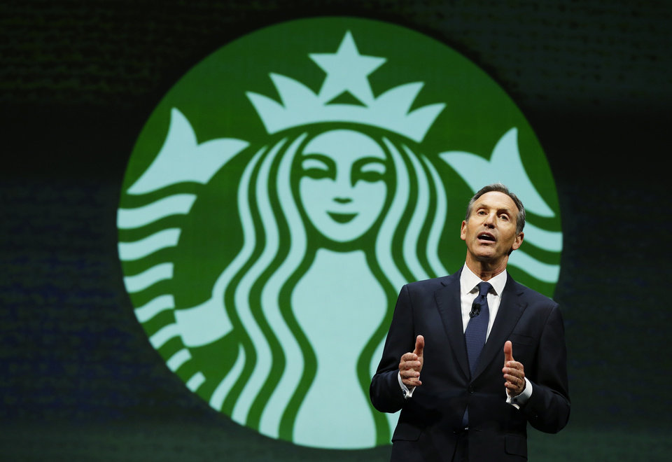 Photo - Howard Schultz, chairman and CEO of Starbucks Coffee Company, speaks Wednesday, March 19, 2014, at the company's annual shareholders meeting in Seattle. (AP Photo/Ted S. Warren)