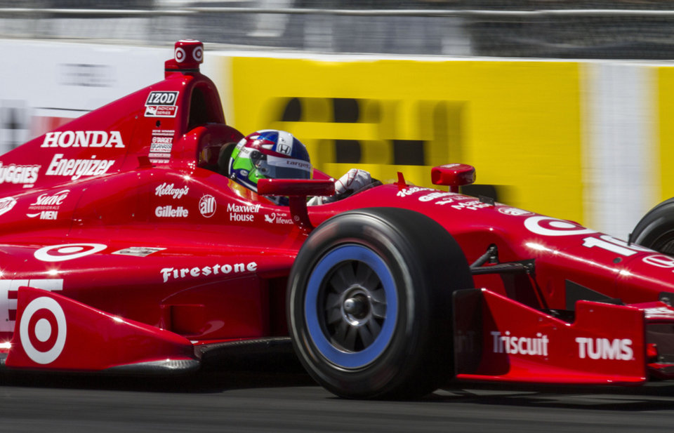 Dario Franchitti, of Scotland, drives during qualifying for the IndyCar Grand Prix of Long Beach auto race Saturday, April 20, 2013, in Long Beach, Calif. Franchitti won the pole for Sunday's race. (AP Photo/Ringo H.W. Chiu)