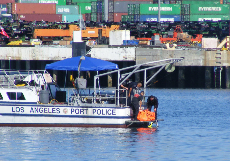 Photo -   In this Sunday, Aug. 19, 2012 photo, Los Angeles Port Police pull the body of Tony Scott from the water beneath the Vincent Thomas Bridge in San Pedro, Calif. Scott, director of such Hollywood blockbusters as