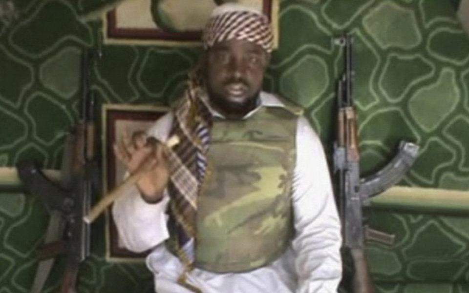 Photo - FILE - This file image made available Wednesday, Jan. 10, 2012, taken from video posted by Boko Haram sympathizers, shows the leader of the radical Islamist sect Imam Abubakar Shekau. Boko Haram has claimed responsibility for the April 15, 2014, mass abduction of nearly 300 teenage schoolgirls in northeast Nigeria. Even before the kidnapping, the U.S. government was offering up to a $7 million reward for information leading to the arrest of Shekau, whom the U.S. has labeled a specially designated global terrorist. (AP Photo/File)