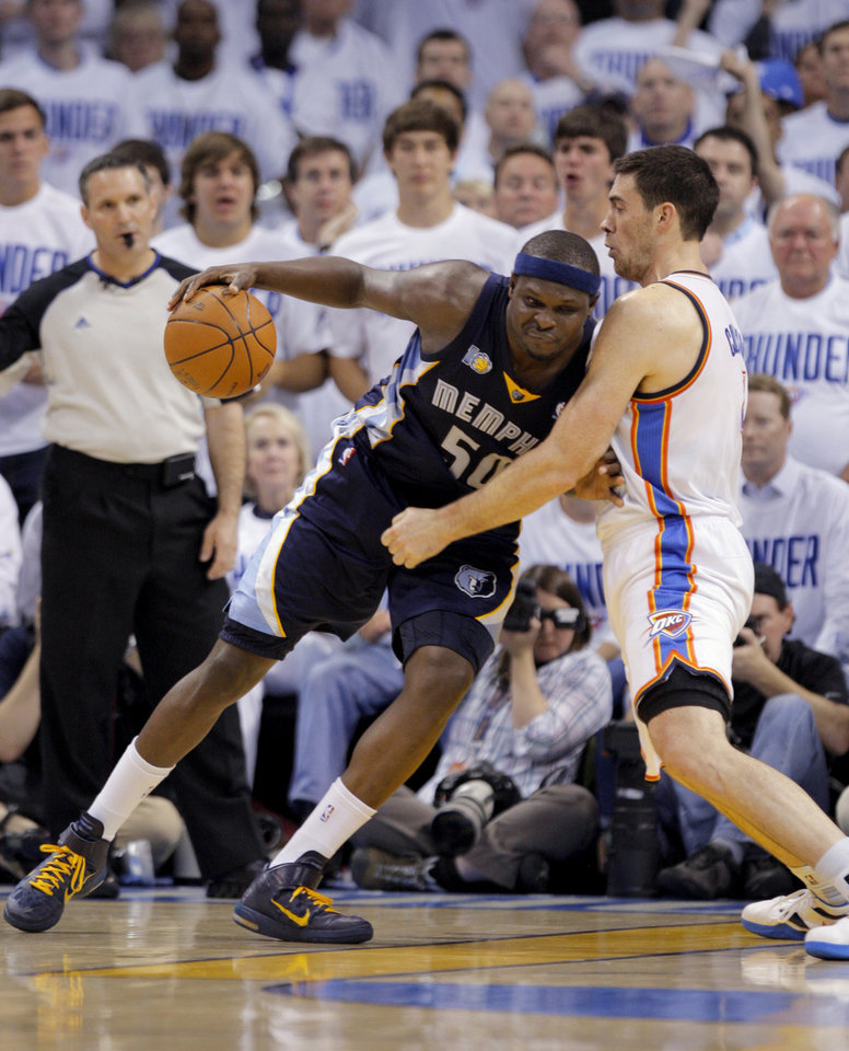 Photo - Zach Randolph (50) of Memphis tries to get by Oklahoma City's Nick Collison (4)during game five of the Western Conference semifinals between the Memphis Grizzlies and the Oklahoma City Thunder in the NBA basketball playoffs at Oklahoma City Arena in Oklahoma City, Wednesday, May 11, 2011. Photo by Bryan Terry, The Oklahoman