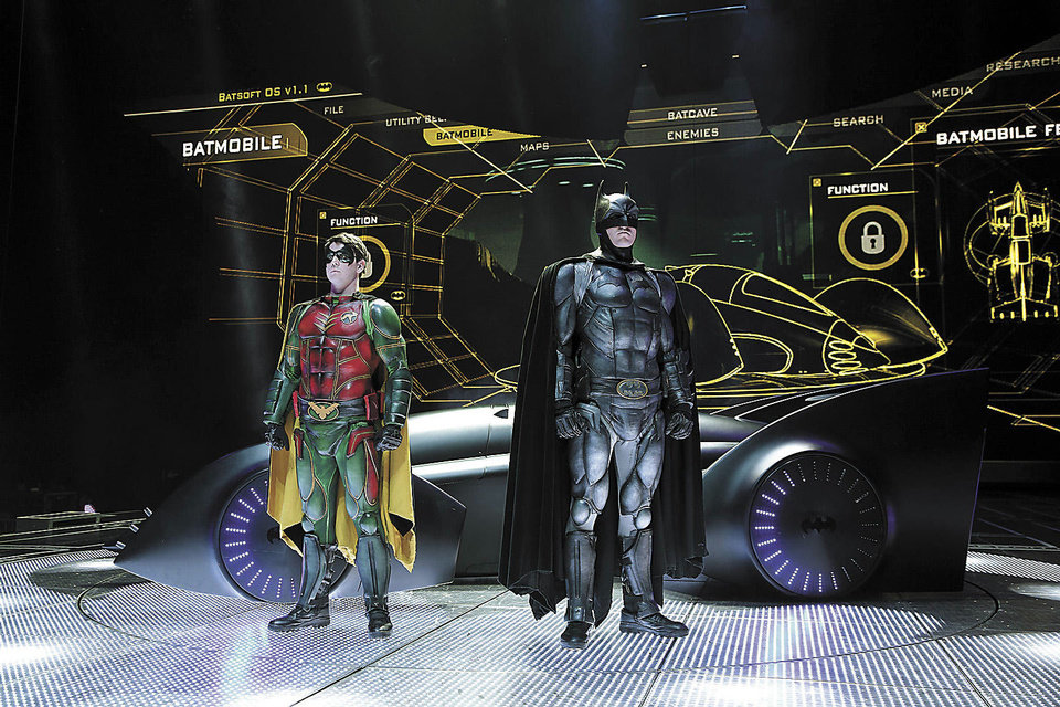 "Photo - Left: Batman and Robin are shown in front of the on the set of ""Batman Live"" on Wednesday at the Chesapeake Energy Arena. Photo by Kyle Roberts, The Oklahoman"