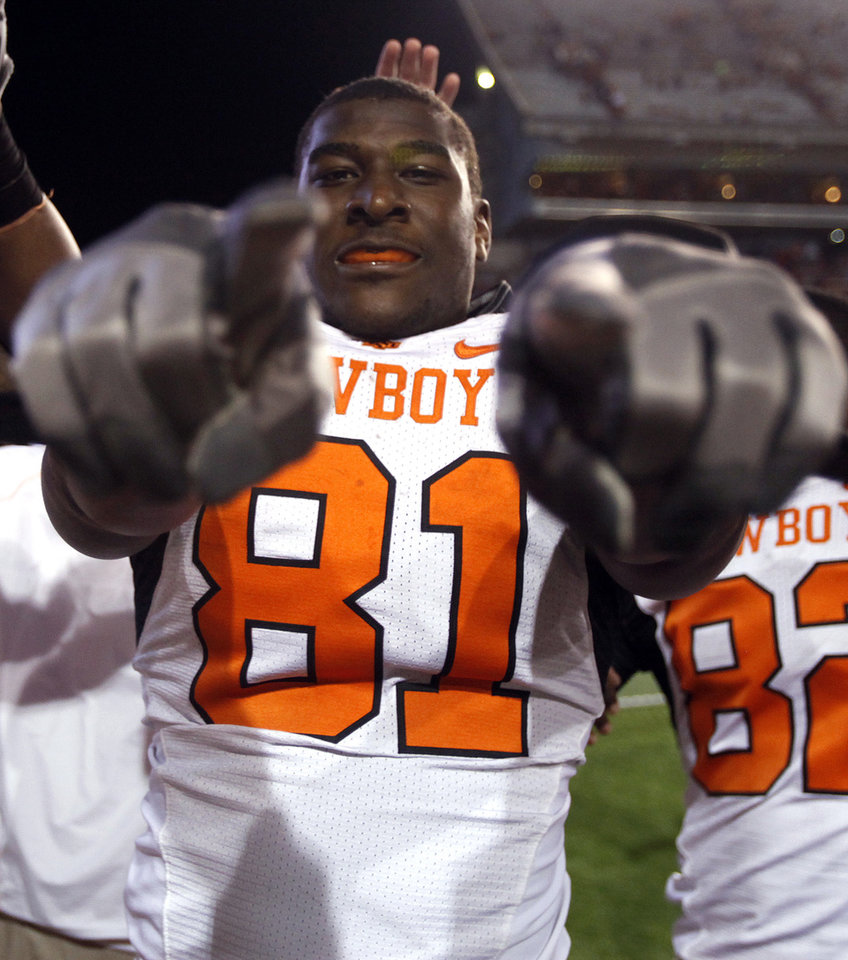 Photo - Oklahoma State's Justin Blackmon (81) celebrates the Cowboys' win over Texas  at Darrell K Royal-Texas Memorial Stadium in Austin, Texas, Saturday, November 13, 2010. Photo by Sarah Phipps, The Oklahoman