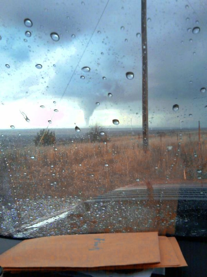 Photo - A tornado is shown about 5:30 p.m. Monday near a wind farm north of Elk City.  Reader SUBMITTED photo By Brad Miller