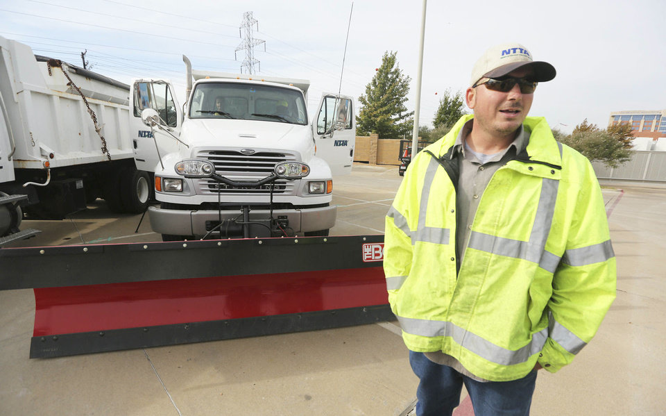Driver Travis Roebuck talks about driving a snowplow Nov. 15 for the North Texas Tollway Authority in Plano, Texas.  AP Photo