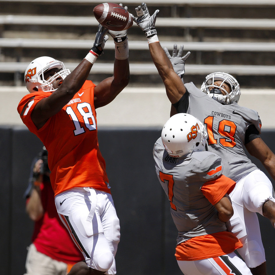 Photo - OSU's Oklahoma State's Brodrick Brown, at right, and Shamiel Gary defend Blake Jackson on an incomplete pass spring football game at Boone Pickens Stadium in Stillwater, Okla., Saturday, April 21, 2012. Photo by Bryan Terry, The Oklahoman