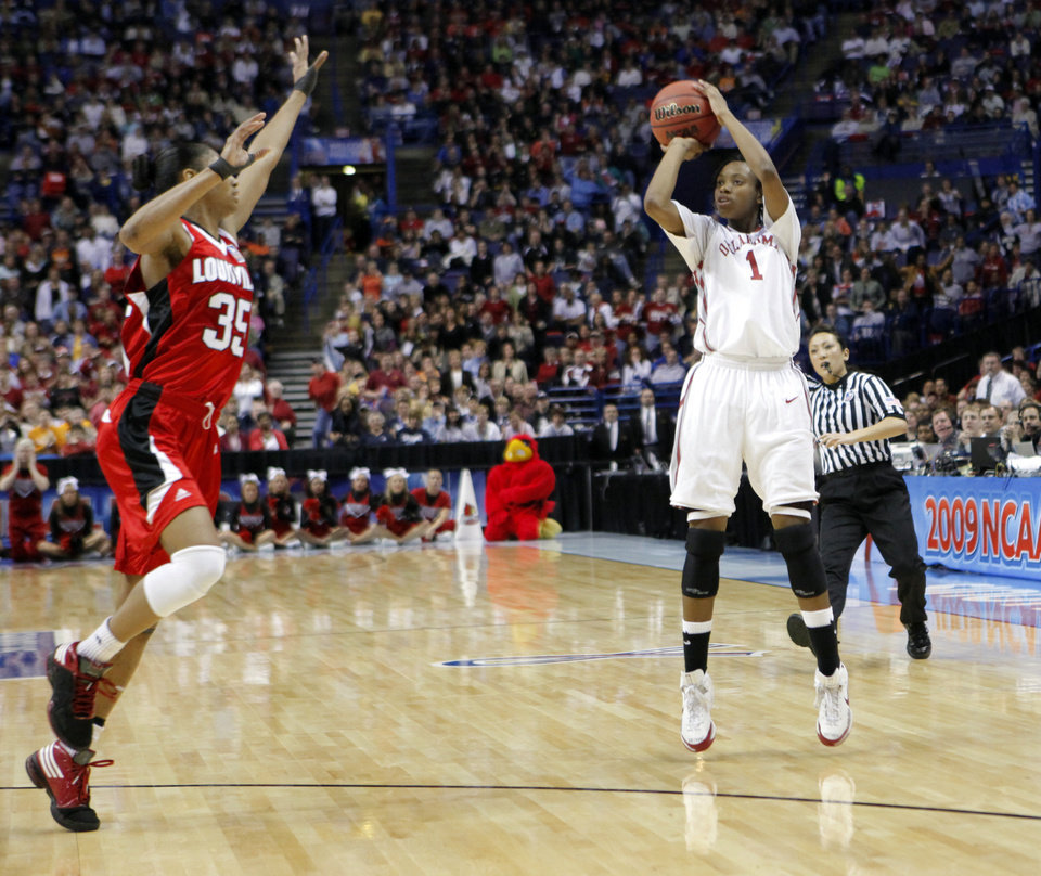 Photo - Sooner Nyeshia Stevenson lines up for a final three point shot at the buzzer as University of Oklahoma is defeated by Louisville 61-59 at the 2009 NCAA women's basketball tournament Final Four in the Scottrade Center in Saint Louis, Missouri on Sunday, April 5, 2009. 