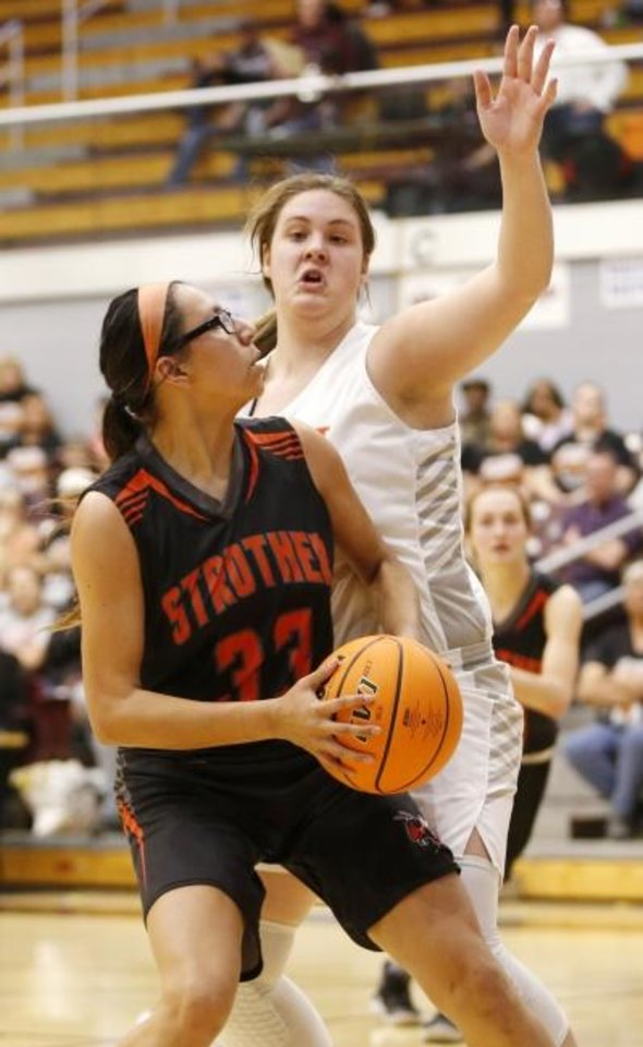 Photo -  Strother's Tafv Harjo (33) averaged 25.5 points per game in the state tournament. [Nate Billings/The Oklahoman]