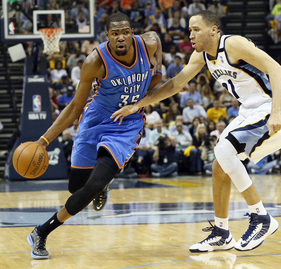 Oklahoma City\'s Kevin Durant (35) drives against Memphis\' Tayshaun Prince (21) during Game 3 in the second round of the NBA basketball playoffs between the Oklahoma City Thunder and Memphis Grizzles at the FedExForum in Memphis, Tenn., Saturday, May 11, 2013. Photo by Nate Billings, The Oklahoman