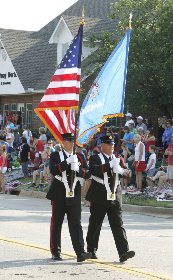 Members of the Edmond Police Dept. carry the US and Oklahoma flags during the annual LibertyFest Fourth of July Parade in downtown Edmond, OK, Thursday, July 4, 2013,  Photo by Paul Hellstern, The Oklahoman