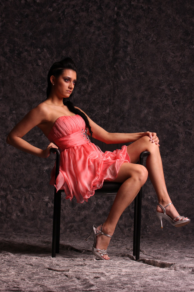 Model Corde wears a coral chiffon cocktail dress, $52.50. Silver metallic sandals, $38.50. All Sold at Deb Shops. Photo by Steve Webb, for The Oklahoman. <strong></strong>