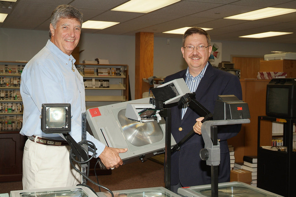 Stan Greil, Dean of Corporate Relations & Workforce Education at Rose State College, presented Bill Scoggan, Superintendent of  Mid-Del Schools, with several overhead projectors on behalf of the  college. Greil was present during meeting where Scoggan mentioned Math teachers were in need of projectors. And as a result, through the efforts of Rose State College, Mid-Del was the beneficiary of eight projectors for Mid-Del classroom teachers.   This is a perfect example of community partners working together for  student success.<br/><b>Community Photo By:</b> Liz Hames<br/><b>Submitted By:</b> natalie,
