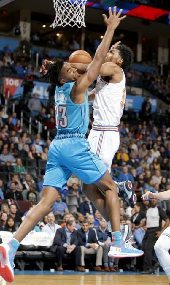 Photo - Oklahoma City's Terrance Ferguson (23) defends against New York's Allonzo Trier (14) during the NBA game between the Oklahoma City Thunder and the New York Knicks at the Chesapeake Energy Arena Nov. 14, 2018. Photo by Sarah Phipps, The Oklahoman