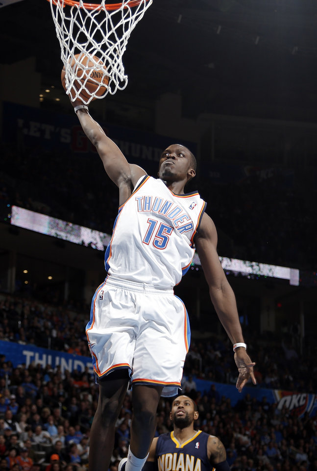 Photo - Oklahoma City's Reggie Jackson (15) dunks during the NBA game between the Oklahoma City Thunder and the Indiana Pacers at the Chesapeake Energy Arena, Sunday, Dec. 8, 2013. Photo by Sarah Phipps, The Oklahoman