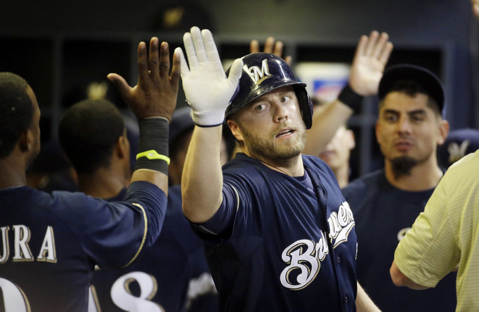 Photo - Milwaukee Brewers' Mark Reynolds is congratulated after hitting a two-run home run during the sixth inning of a baseball game against the Philadelphia Phillies Tuesday, July 8, 2014, in Milwaukee. (AP Photo/Morry Gash)