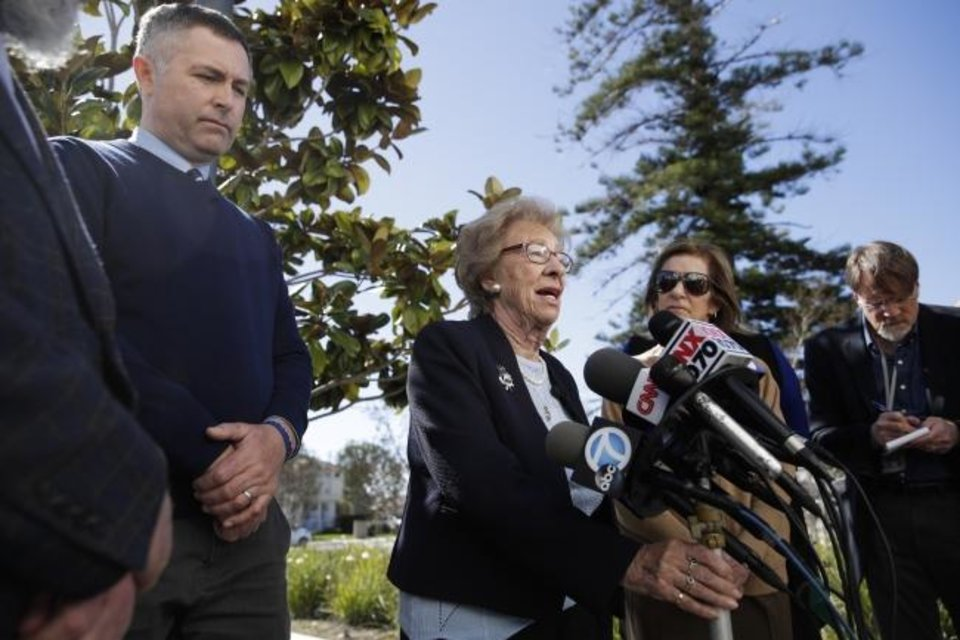 Photo -  Holocaust survivor Eva Schloss, who is the stepsister of Anne Frank, is joined in this March photo by Newport Harbor High School Principal Sean Boulton, left, as she talks to reporters after meeting with Southern California high school students who were photographed at a party giving Nazi salutes around a swastika formed by drinking cups. [AP File Photo]