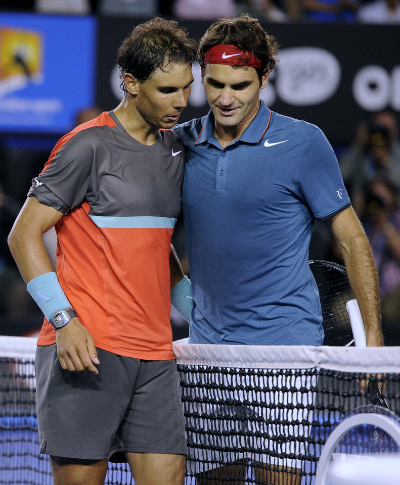 Photo - Rafael Nadal of Spain, left, is congratulated by Roger Federer of  Switzerland at the net after Nadal won their semifinal final at the Australian Open tennis championship in Melbourne, Australia, Friday, Jan. 24, 2014.(AP Photo/Andrew Brownbill)