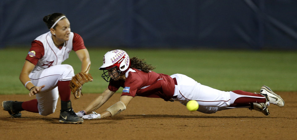 Photo - OU's Callie Parsons slides to second base beside Alabama's Kaila Hunt in the fourth inning of a Women's College World Series game between at ASA Hall of Fame Stadium in Oklahoma City Thursday, May 29, 2014. Photo by Bryan Terry, The Oklahoman