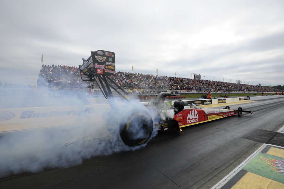 Photo - In this photo submitted by the NHRA, Doug Kalitta took the top qualifying position in Top Fuel for the Summit Racing Equipment NHRA Southern Nationals at Atlanta Dragway, Saturday, May 17, 2014, in Commerce, Ga. This is his third No. 1 qualifying effort of the season and the 39th of his career. He will face Chris Karamesines in the first round of eliminations on Sunday. (AP Photo/NHRA, Marx Gewertz)