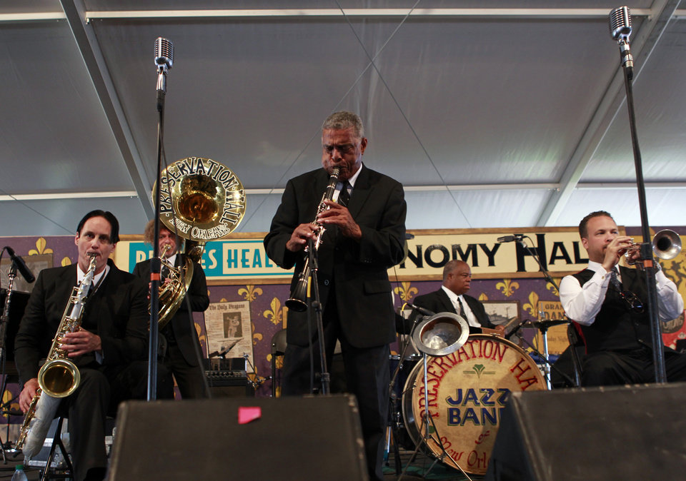 Photo -   In this Saturday, May 5, 2012 photo, the Preservation Hall Jazz Band performs at the New Orleans Jazz and Heritage Festival in New Orleans. For five decades, Preservation Hall has served up New Orleans jazz for music lovers the world over. The New Orleans Jazz and Heritage Festival, on its closing weekend, marked that achievement by showcasing the world-renowned Preservation Hall Jazz Band in concert twice. (AP Photo/Gerald Herbert)