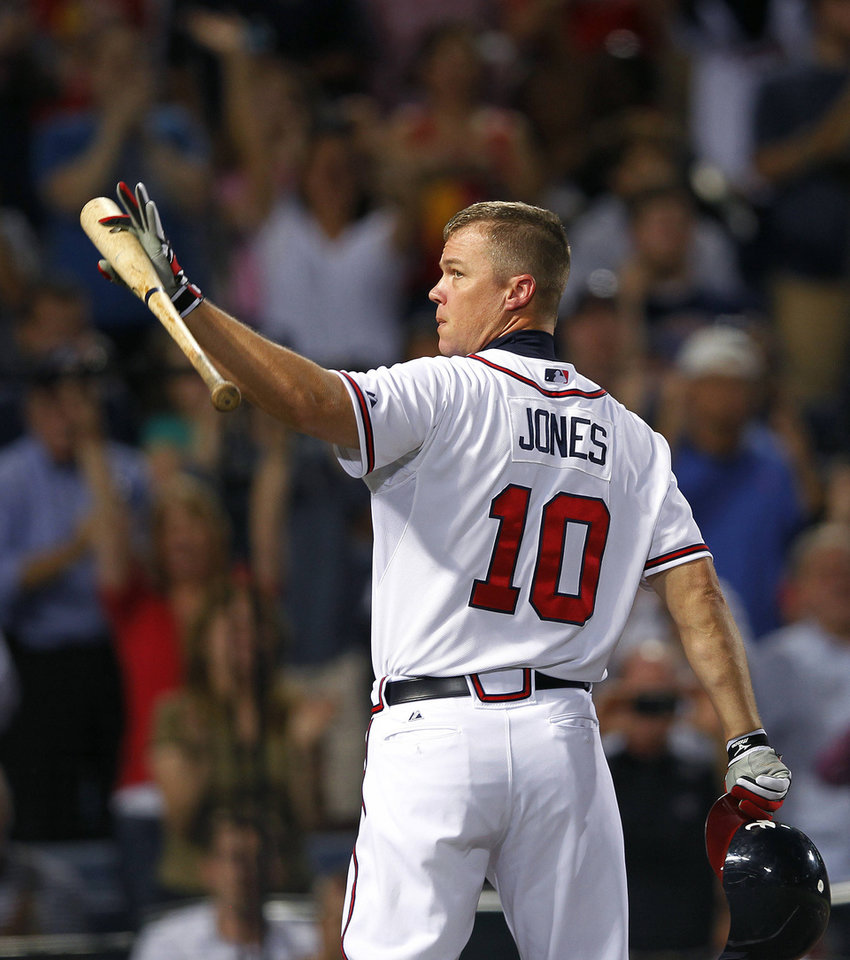 Photo -   Atlanta Braves third baseman Chipper Jones (10) waves to the crowd before batting in the second inning of a baseball game against the Miami Marlins in Atlanta, Thursday, Sept. 27, 2012. (AP Photo/John Bazemore)