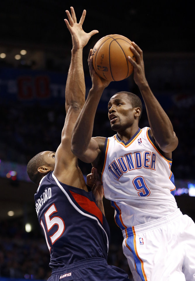 Oklahoma City Thunder\'s Serge Ibaka (9) shoots guarded by Atlanta Hawk\'s Al Horford (15) as the Oklahoma City Thunder play the Atlanta Hawks in NBA basketball at the Chesapeake Energy Arena in Oklahoma City, on Sunday, Nov. 4, 2012. Photo by Steve Sisney, The Oklahoman
