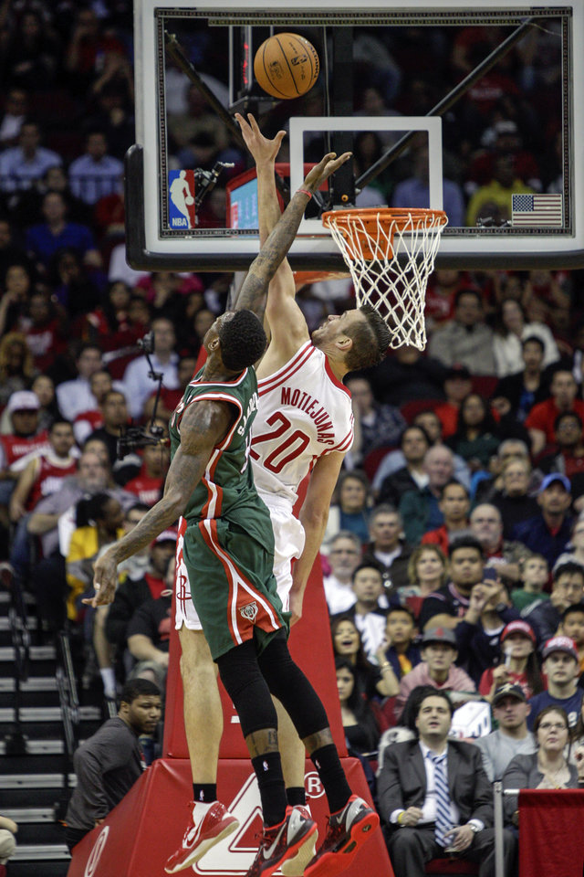 Houston Rockets forward Donatas Motiejunas (20) and Milwaukee Bucks center Larry Sanders (8) battle for the rebound during the second half of an NBA basketball game, Wednesday, Feb. 27, 2013 in Houston. Milwaukee won 110-107. (AP Photo/Bob Levey)