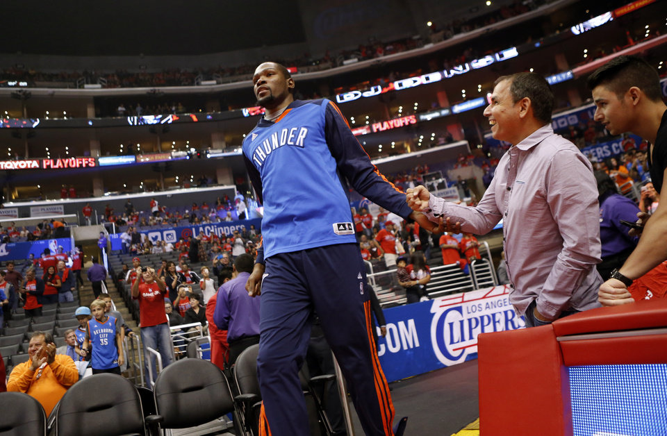 Photo - Oklahoma City's Kevin Durant (35) walks on to the court for warm ups during Game 3 of the Western Conference semifinals in the NBA playoffs between the Oklahoma City Thunder and the Los Angeles Clippers at the Staples Center in Los Angeles, Friday, May 9, 2014. Photo by Nate Billings, The Oklahoman