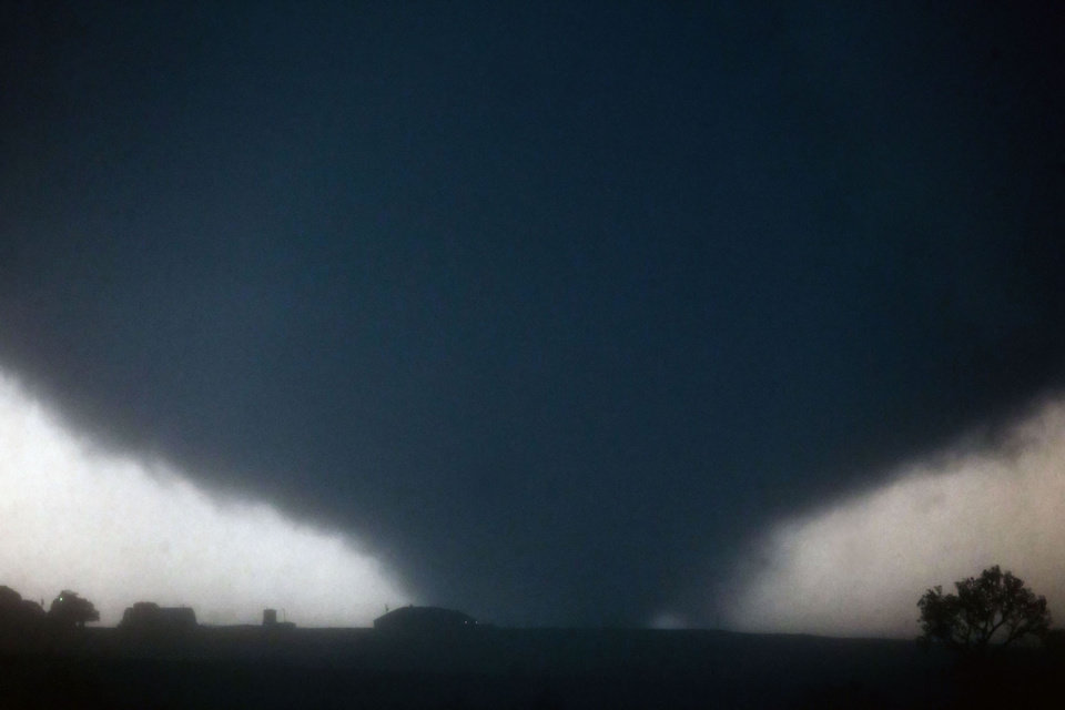 A tornado on the ground near El Reno, Oklahoma just south of Interstate 40 on Friday May 31, 2013. Several tornadoes in the area caused damage and injuries. Photo by Chris Machian/The World Herald