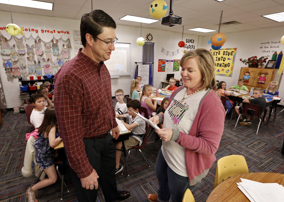 Photo - Tuttle school superintendent Bobby Waitman and second grade teacher Misti Paxton talk at the elementary school on Thursday, April 12, 2018 in Tuttle, Okla.  Photo by Steve Sisney, The Oklahoman