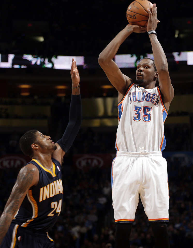 Oklahoma City's Kevin Durant (35) shoots over Indiana's Paul George (24) during the NBA game between the Oklahoma City Thunder and the Indiana Pacers at the Chesapeake Energy Arena, Sunday, Dec. 8, 2013. Photo by Sarah Phipps, The Oklahoman