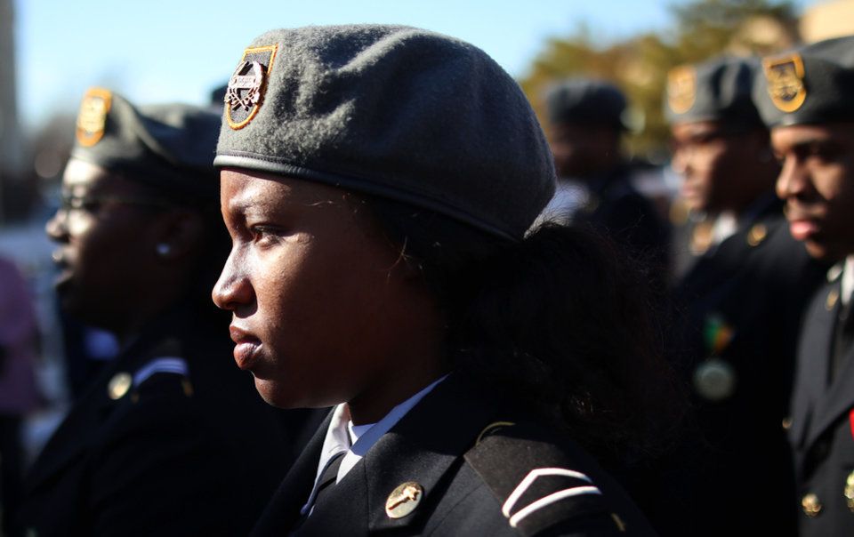 Photo - Members of Classen SAS JROTC march along the route for the MLK Day Parade along Walker Ave. during celebrations of Dr. Martin Luther King, Jr. holiday, Monday, January 20, 2019. [Photo by Doug Hoke/The Oklahoman]