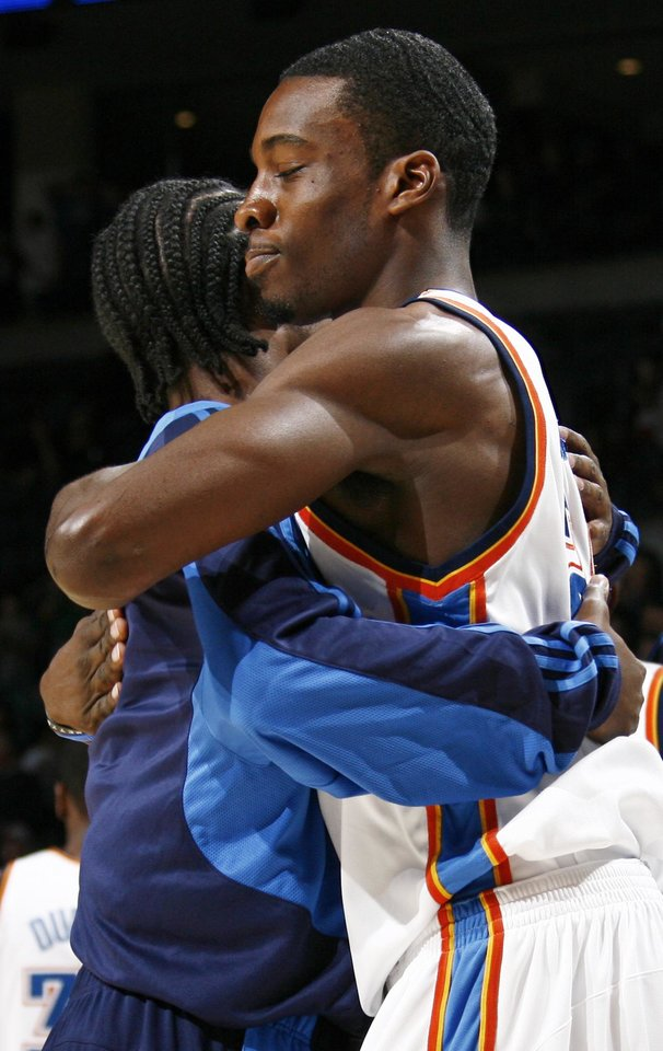 Photo - Oklahoma City's Jeff Green, right, and Kyle Weaver hug before the NBA basketball game between the Golden State Warriors and the Oklahoma City Thunder at the Ford Center in Oklahoma City, Monday, December 8, 2008. BY NATE BILLINGS, THE OKLAHOMAN  ORG XMIT: KOD