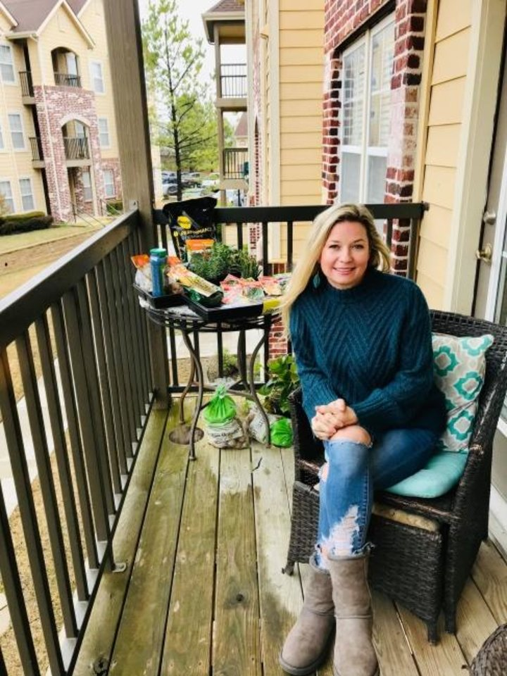 Photo -  Jennifer Blackwell is on her balcony in Owasso with vegetable transplants and seeds she bought for a container garden when she realized the gravity of the coronavirus outbreak. [PROVIDED]