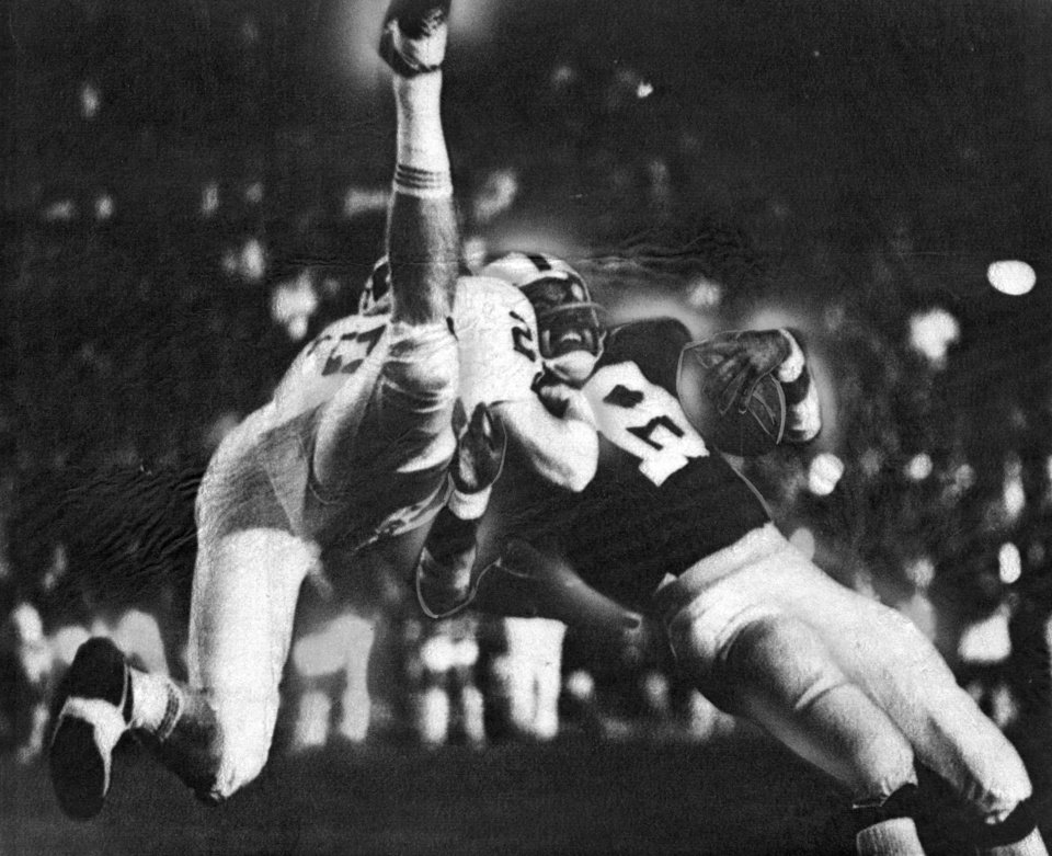 Kenith Pope makes a flying tackle on Penn State's Jimmy Scott in the 1973 Sugar Bowl. Pope is now an assistant coach at Iowa State. OKLAHOMAN ARCHIVE PHOTO