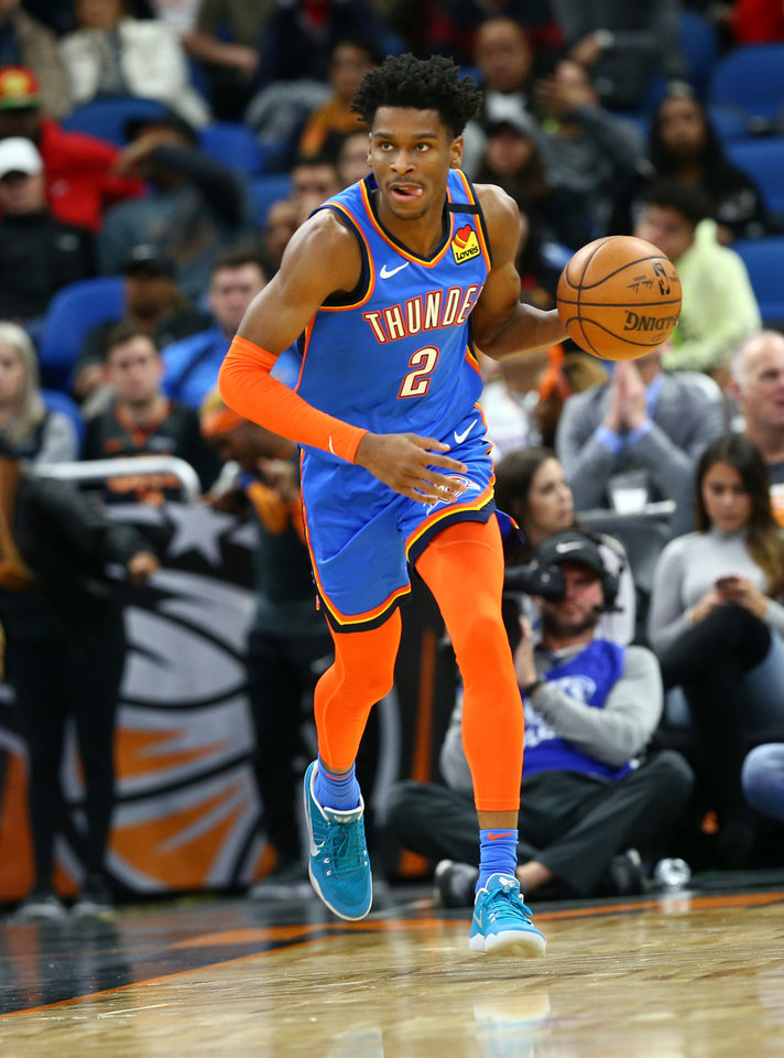 Photo - Jan 22, 2020; Orlando, Florida, USA; Oklahoma City Thunder guard Shai Gilgeous-Alexander (2) drives to the basket against the Orlando Magic during the first half at Amway Center.  [Kim Klement/USA TODAY Sports]