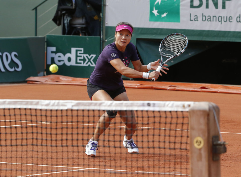 Photo - Li Na from China, returns the ball during a training session for the French Open tennis tournament, at the Roland Garros stadium in Paris, Saturday, May 24, 2014. The French Open tennis tournament starts Sunday. (AP Photo/Michel Euler)
