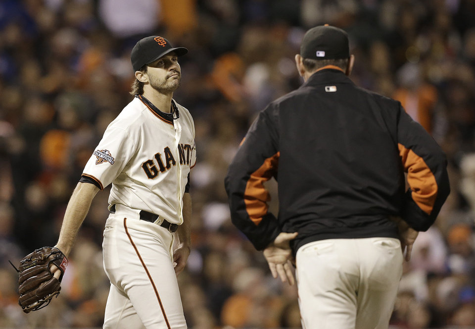 Photo - San Francisco Giants manager Bruce Bochy, right, checks on pitcher Barry Zito after Zito was hit by Los Angeles Dodgers' Nick Punto's single during the fifth inning of a baseball game in San Francisco, Wednesday, Sept. 25, 2013. (AP Photo/Jeff Chiu)