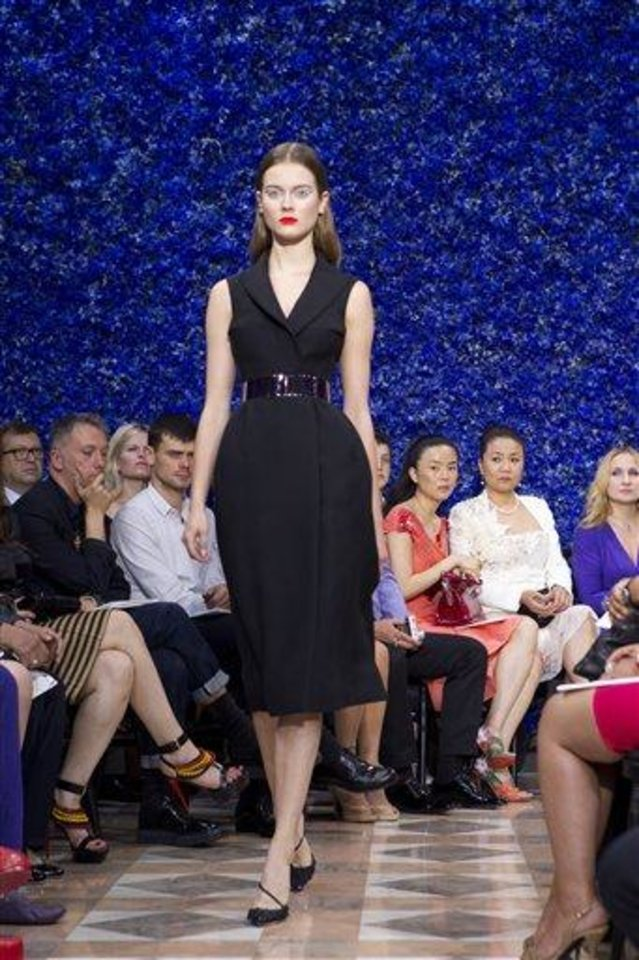 Photo - A model wears a creation by fshion designer Raf Simons for Dior's Haute Couture Fall-Winter 2013 collection presented in Paris, Monday July 2, 2012. (AP Photo/Jacques Brinon)