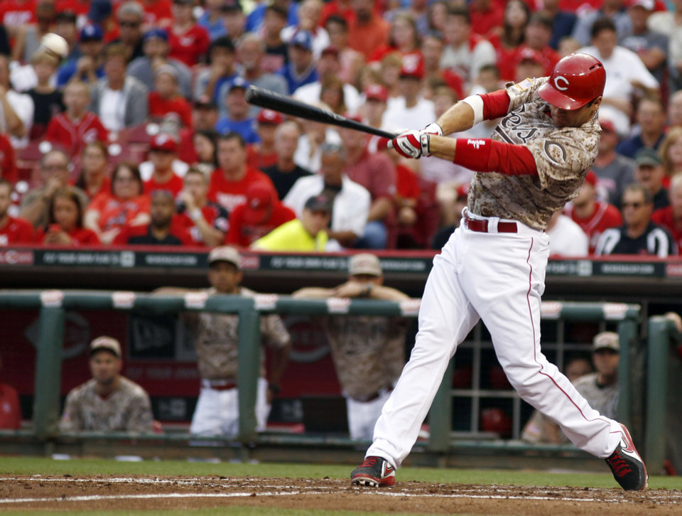 Photo - Cincinnati Reds' Joey Votto hits a two-run double off Los Angeles Dodgers starting pitcher Hyun-Jin Ryu during the third inning of a baseball game, Wednesday, June 11, 2014, in Cincinnati. (AP Photo/David Kohl)