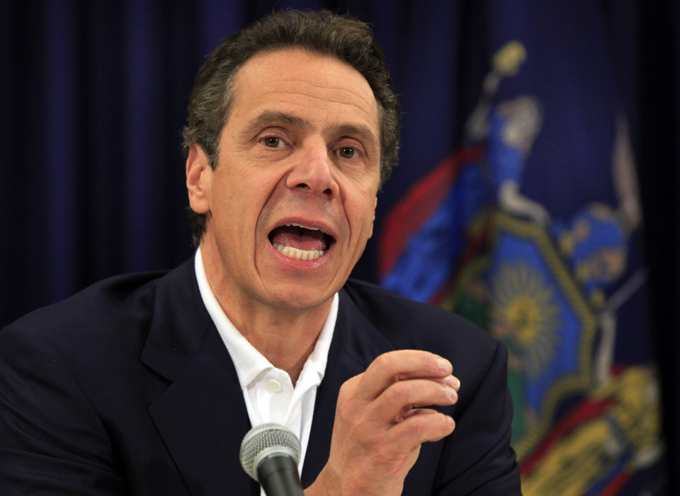 Photo -  New York Gov. Andrew Cuomo makes a point a news conference in New York, Thursday, Nov. 8, 2012. Gov. Cuomo said damage in New York state from Superstorm Sandy could total $33 billion when all is said and done, as the state began cleaning up from a nor'easter that dumped snow, brought down power lines and left hundreds of thousands of new customers in darkness. (AP Photo/Richard Drew)