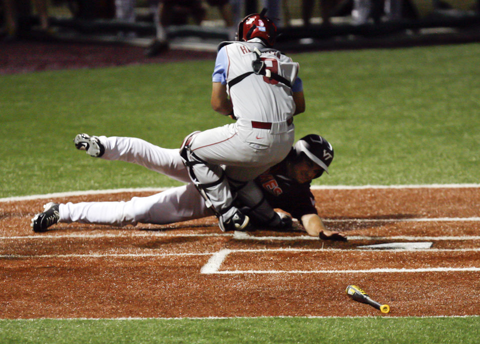 Virginia Tech's Andrew Rash, bottom, is tagged out by Oklahoma's Anthony Hermelyn, top, in the bottom of the seventh inning of an NCAA college baseball tournament regional game at English Field in Blacksburg, Va., Sunday, June 2, 2013.  (AP Photo/Michael Shroyer) ORG XMIT: VAMS158