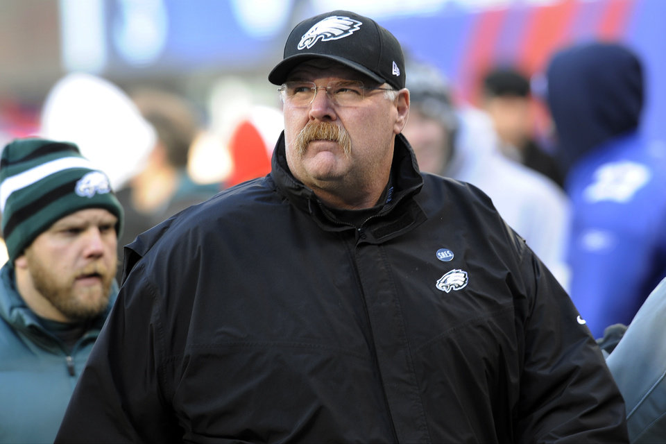 Photo - Philadelphia Eagles head coach Andy Reid walks on the field before an NFL football game against the New York Giants, Sunday, Dec. 30, 2012, in East Rutherford, N.J. (AP Photo/Bill Kostroun)