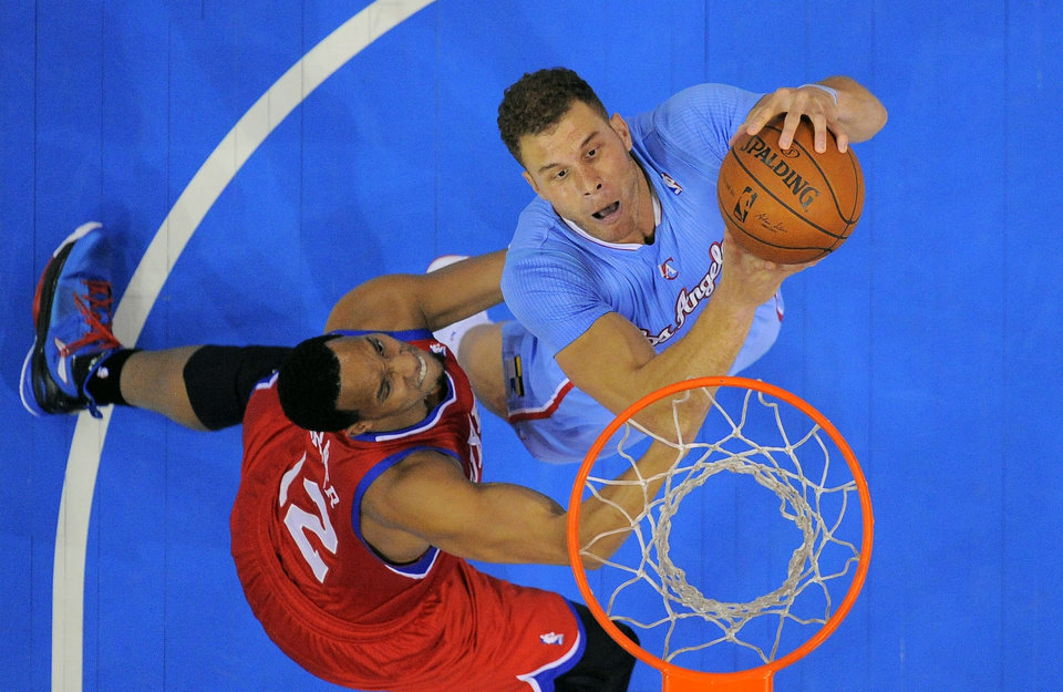 Photo - Los Angeles Clippers forward Blake Griffin, right, puts up a shot as Philadelphia 76ers forward Evan Turner defends during the first half of an NBA basketball game Sunday, Feb. 9, 2014, in Los Angeles. (AP Photo/Mark J. Terrill)