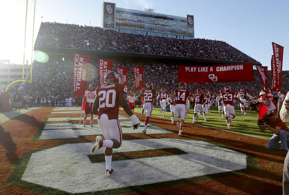 Photo - The Oklahoma team takes the field before a college football game between the University of Oklahoma Sooners (OU) and the TCU Horned Frogs at Gaylord Family-Oklahoma Memorial Stadium in Norman, Okla., on Saturday, Oct. 5, 2013. Oklahoma won 20-17. Photo by Bryan Terry, The Oklahoman