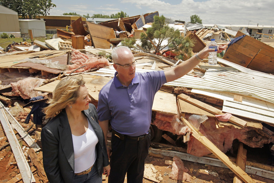 Oklahoma Governor Mary Fallin and Chickasha Mayor Hank Ross visit a mobile home complex on Wednesday, May 25, 2011, in Chickasha, Okla. Laron Short died in the complex during Tuesday\'s tornado outbreak. Photo by Steve Sisney, The Oklahoman